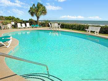 Sparkling pool overlooking the Atlantic ocean at The Best Western Carolinian in Myrtle Beach