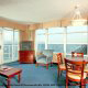 Large living room with walls of glass to overlook the ocean at The Best Western Carolinian in Myrtle Beach