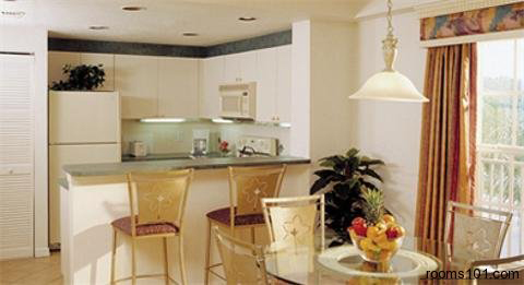 Spacious Suite with Kitchen and Round Table at Mystic Dunes Resort & Golf Club in Orlando, Florida.