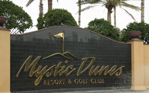 Resort Welcome Sign View at Mystic Dunes Resort & Golf Club in Orlando, Florida.