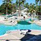 Lagoon Style Pools and Whirlpool Spa at Oak Plantation Resort in Orlando, Florida. Affordable vacation packages now available at Rooms101.com.