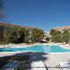 Outdoor Pool View with Chaise Lounge Chairs at the Ocean View Vacation Villas in Biloxi, Mississippi.