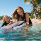 Discovery Cove allows visitors to have intimate contact with dolphins while on vacation to Seaworld in Orlando, Florida.