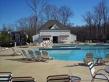 Serene Outdoor Pool View at Kings Creek Plantation in Williamsburg, VA. Take a refreshing splash in the cool waters during your Spring Break Family Getaway.