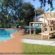 Outdoor playground and pool area at The Florida Vacation Villas.
