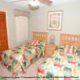 Twin bed bedroom at The Florida Vacation Villas.