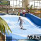 Surfing at the wave pool in the water park at the Wilderness Stone Hill Lodge in Pigeon Forge Tennessee.