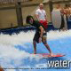 Kids having fun surfing in the wave pool at the Wilderness Stone Hill Lodge in Pigeon Forge Tennessee.