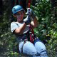 Lady rider soaring through the air at zipline adventures in Pigeon Forge Tennessee.