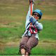 Another happy female rider at zipline adventures in Pigeon Forge Tennessee.