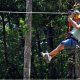 Using the glove hand to slow down at zipline adventures in Pigeon Forge Tennessee.