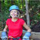 Young lady with a big smile waits her turn to ride at zipline adventures in Pigeon Forge Tennessee.